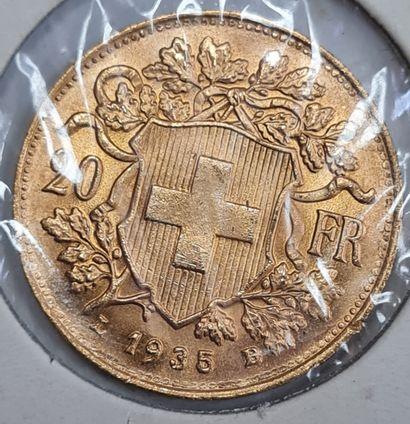 SUISSE, 20 Francs or 1935 B, Poids : 6,4 g. TTB/SUP