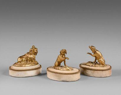44- Suite de trois sculptures en bronze doré...