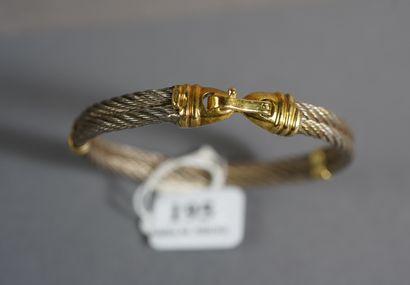 195- Bracelet en or et acier  Pds : 22,7...