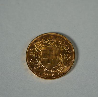 215- Pièce de 20 F Suisse en or datée 19...