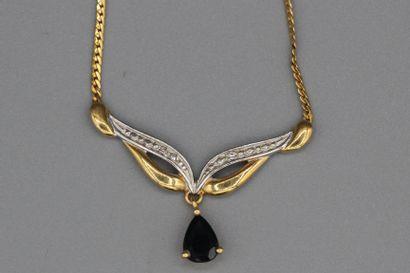 139- Collier en or orné d'un saphir poire...
