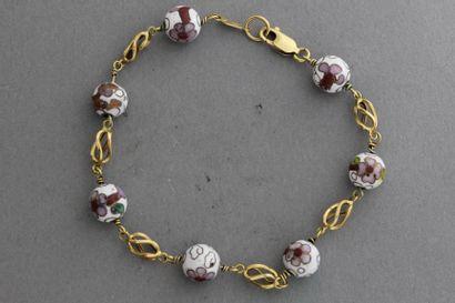 209- Bracelet en or orné de boules émaillées...