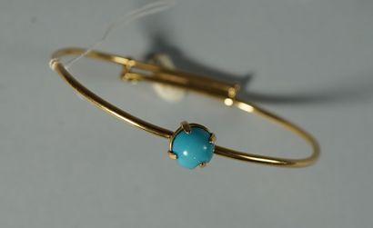 80- Bracelet jonc en or jaune serti d'une...