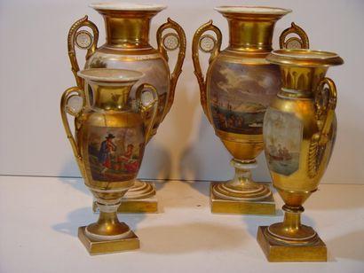 Quatre vases en porcelaine de Paris. (Accidents...