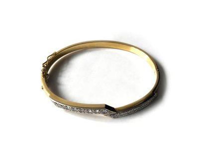 Bracelet jonc ouvrant en or jaune 750 millièmes...