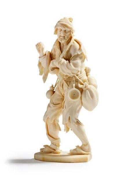 *Mendiant Sujet en ivoire finement sculpté...