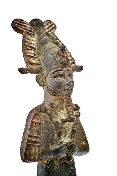 Statuette of Osiris Votive statuette representing the god Osiris, standing, mummiform,...