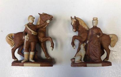 Paire de statuettes Couple de chasseurs à...