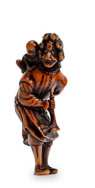 JAPON - Epoque EDO (1603 - 1868) Netsuke en buis, hollandais debout souriant largement,...