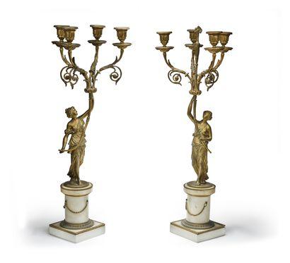 Paire de candélabres à quatre bras de lumière...