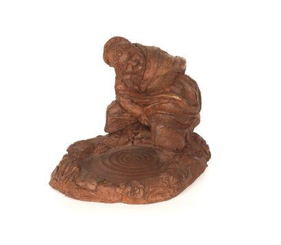 Vieille accroupie Sculpture en terre frustre...