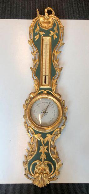 Baromètre-thermomètre en bois mouluré, sculpté,...
