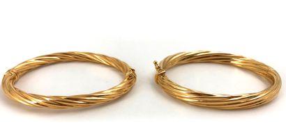 Deux bracelets en or jaune 18K 750°/°°...