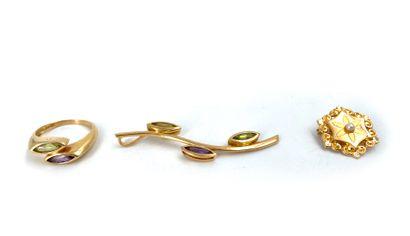 Lot en or jaune 18K 750°/°° comprenant un pendentif en forme de feuille serti de...