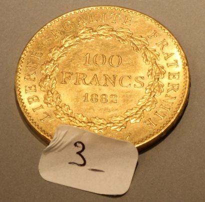 Une pièce de 100 F or 1882. (32,24g)
