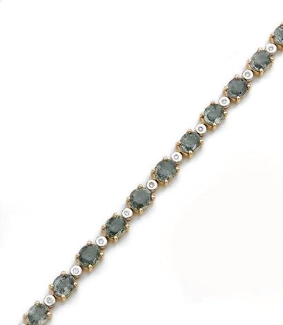 Bracelet ligne en or 14k bicolore, orné d'une...