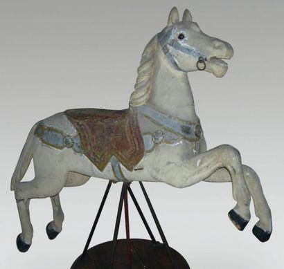 Cheval de manège en bois sculpté, polychrome....