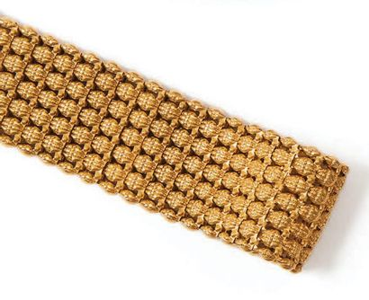 Bracelet en or jaune 18K (750°/00) articulé...