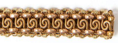 Bracelet en or trois tons 18K (750°/00) ciselé...