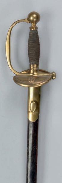 Epée d'officier d'infanterie modèle 1816 Fusée filigranée d'argent. Monture en en...