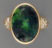 Bague opale cabochon, en or et diamants