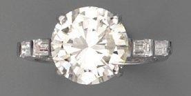 Bague diamant brillanté (4 cts env) et diamants,...