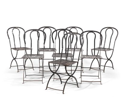 SUITE OF EIGHT PARISIAN GARDEN CHAIRS  Black painted iron, the curved back, openwork,...
