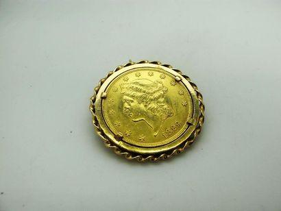 Monnaie de 20 dollars or 1899 montée en broche...