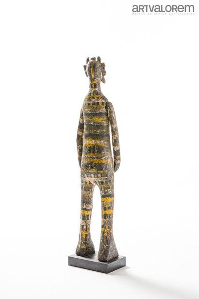 Poupée à bras articulés SENOUFO (République de Côte d'Ivoire) en bois couvert de...