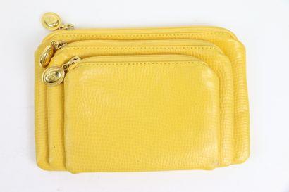 CHRISTIAN DIOR  Trois pochettes en cuir jaune...