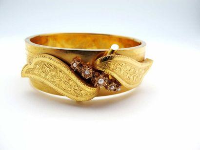 Bracelet rigide ouvrant en or jaune 750°/oo...