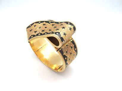 Bracelet jonc articulé en or jaune 750°/oo...