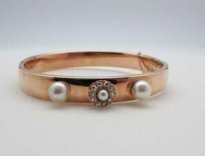 Bracelet rigide ouvrant en or rose 750°/oo...