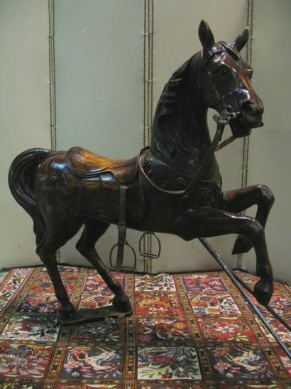 Cheval de manège cabré en bois vernis. (renforts, restaurations) Attribué à BAYOL...