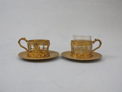 Deux porte-tasses et sous-tasses en vermeil...