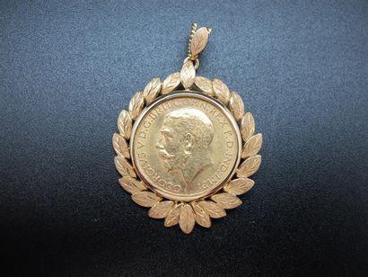 Une monnaie en or, Souverain, 1918, montée...