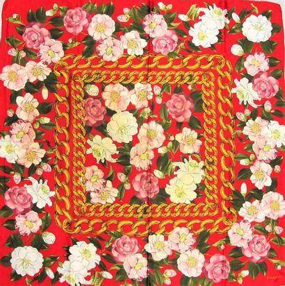 CHANEL. Trois foulards en soie imprimée à...