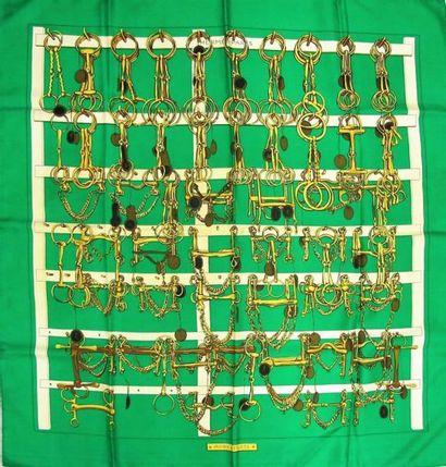 HERMES. Carré en soie imprimée, titré