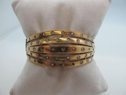 Bracelet jonc articulé en or jaune 750°/°°...