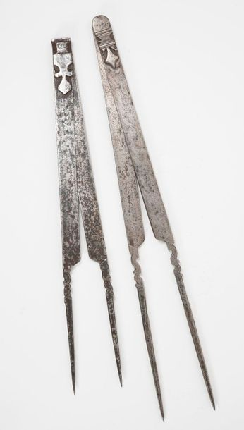 Two carpenter's compasses made of beaten and cut iron.  Shafts decorated with stylized...
