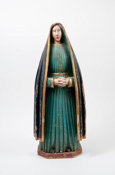 ESPAGNE, XVIIIème-XIXème siècles  Religieuse en pleurs, les mains croisées.  Sculpture...