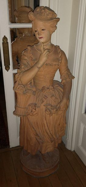 Garden statue, from the first half of the 20th century. Woman in 18th century dress...