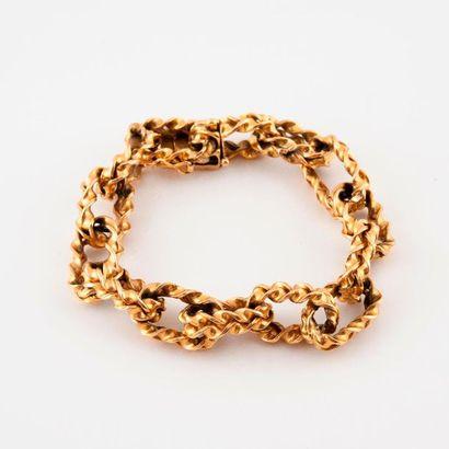 Bracelet en or jaune (750) à maillons forçats...