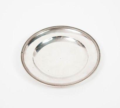 Sous tasse ronde en argent (950) bordée d'une...