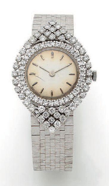 Élégante montre bracelet de dame en or gris...