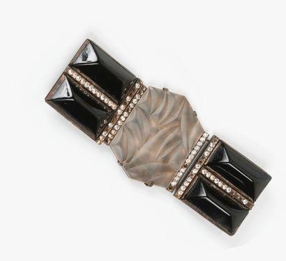 Elément de ceinture orné d'un motif feuillagé...