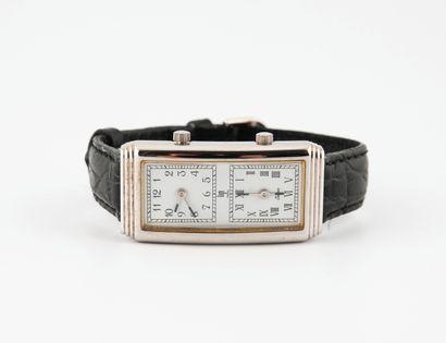 LIP Montre bracelet.  Boîtier rectangulaire en acier.  Cadran blanc, signé, à deux...