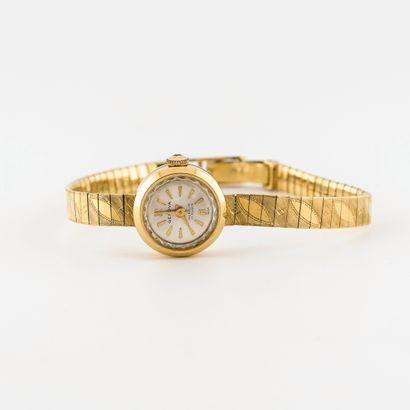 Genova Montre bracelet de dame en or jaune (750).  Boîtier rond.  Cadran à fond satiné...