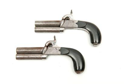 BELGIQUE Paire de pistolets à percussion à capsule, à deux coups. A coffres gravés...