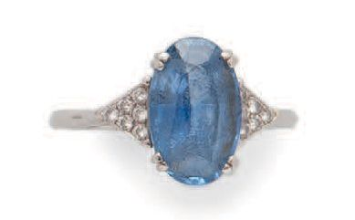 Platinum (750) ring centered on a faceted...